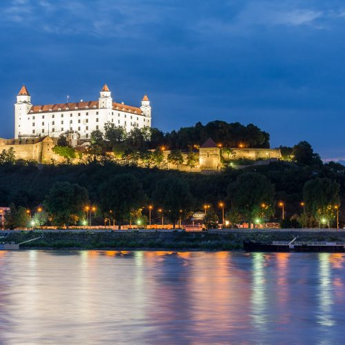 Castle in Bratislava after sunset with reflection