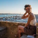 girl laughing lisbon sunset