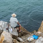 guy sitting fishing nazare